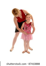 A Ballet Mistress Instructs a Smiling Young Girl Student