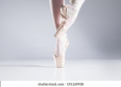 Ballet On Toes. Legs of a graceful ballet dancer en pointe on toes.