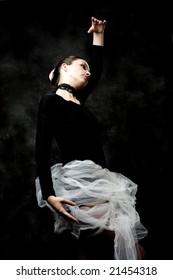 ballet pose, dark background