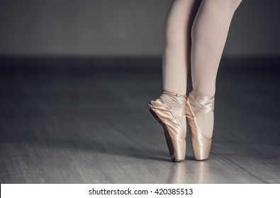 Ballet shoes. Detail shot of ballerina legs.