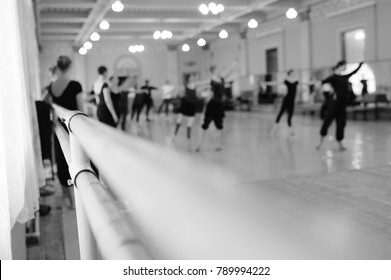 The ballet troupe rehearses in a ballet class against the backdrop of a ballet or barre