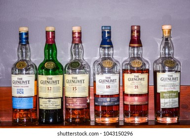 BALLINDALLOCH, MORAY / SCOTLAND - AUGUST 24, 2016: Series of various The Glenlivet Single Malt Scotch whisky bottels in the Glenlivet Distillery