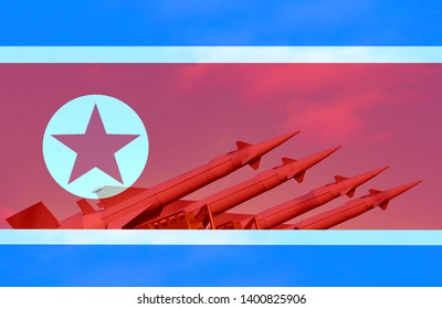 Ballistic missiles on the background of the flag of the country of North Korea. Concept of politics or war