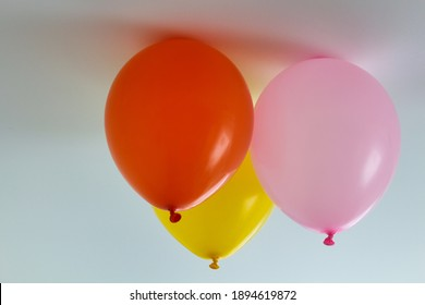 ballon on the roof. this balloons are not filled with helium. The balloons stick to the ceiling with an electrostatic charge