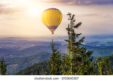 balloon amid blue sky . soar in the clouds