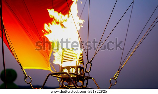 A balloon burner in operation with its hot flame