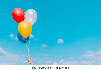 balloon with colorful on blue sky, vintage tone
