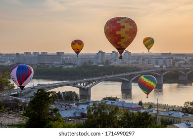 Balloon Festival over the city, bridge and the river in Russia.