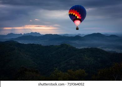 Balloon float over beautiful nature at Phu Bo Bit (Loei, Thailand) , Beautiful landscape over the Loei city at dusk.