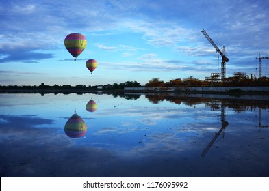 Balloon floating over the water in the evening.