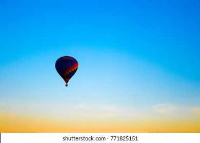 The balloon floating in the sky.