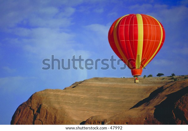 Balloon flying over Sandstone Formation