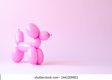 Balloon in the form of a dog on a pink background.