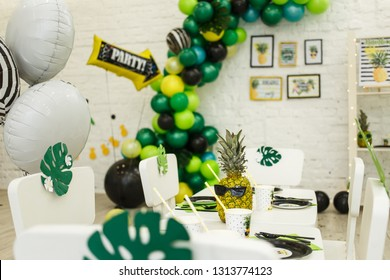 "Balloon in the form of a pointer with the words ""party"". The ball indicates the decorated area for recreation and dance with colorful balloons, garlands and various decorations"