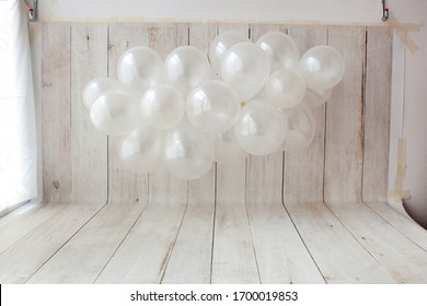 Balloon garland on wooden background. Birthday party photo zone.