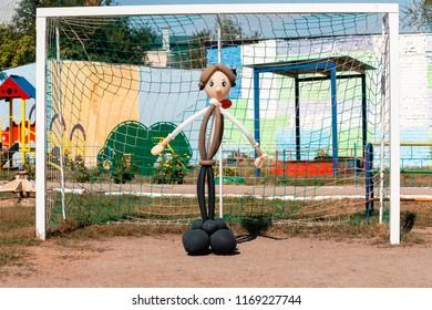 Balloon man dolly in the summer sun on the school garden