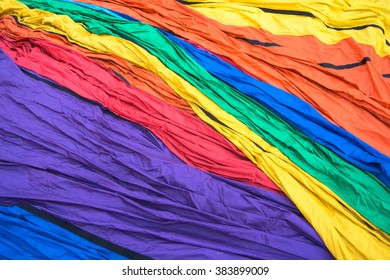 balloon material with its colorful cloth pattern laid out on ground