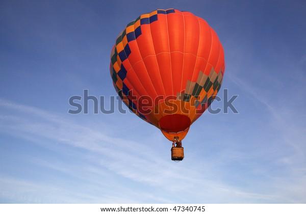 Balloon on the blue sky