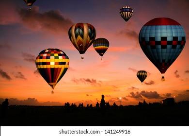 A balloon race at sunrise.