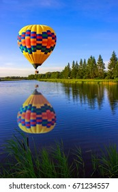 A balloon with reflection over the canal.