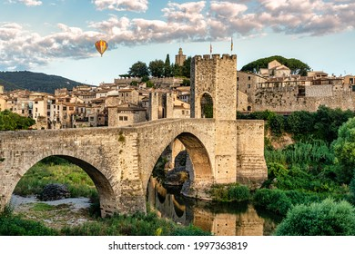 Balloon trip over the medieval village of Besalú en Girona, Catalonia, Spain. Foreground of medieval bridge - Nacional park of Garrotxa