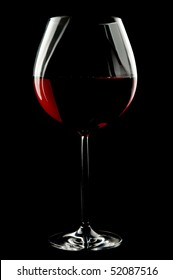 Balloon wineglass for bold,rich red wines over black backgroud.