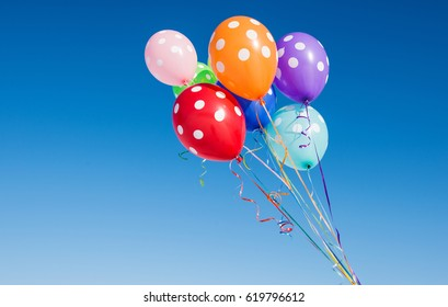 Balloons against the blue sky