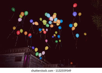 Balloons air in the dark sky