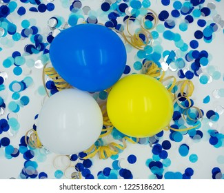 Balloons with blue confetti, yellow streamers on white background