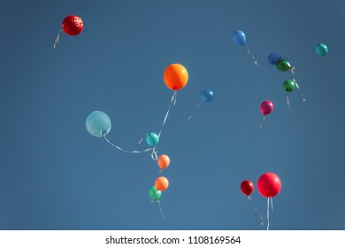 Balloons In Clear Blue Sky