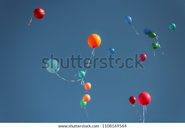 balloons-clear-blue-sky-600w-1108169564.