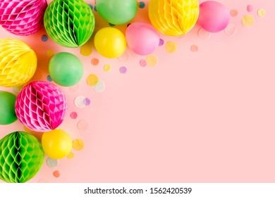 Balloons and confetti on pink background.  Birthday, holiday concept. Flat lay, top view. Birthday party background