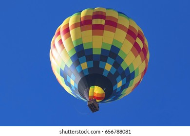 Balloons float over California winery vineyard during Balloon Festival