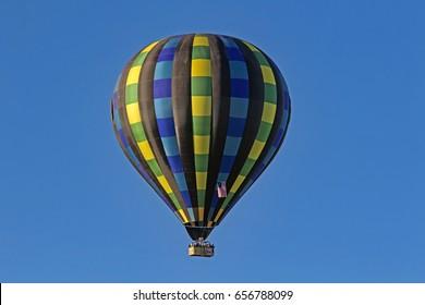 Balloons float over California winery vineyard during Balloon Festival