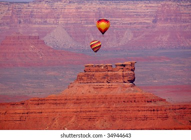 Balloons floating over Valley of the Gods, Utah