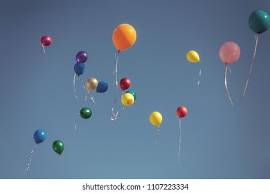 Balloons Flying Up In Clear Sky