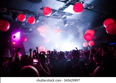 Balloons flying over the crowd during the concert. Live show