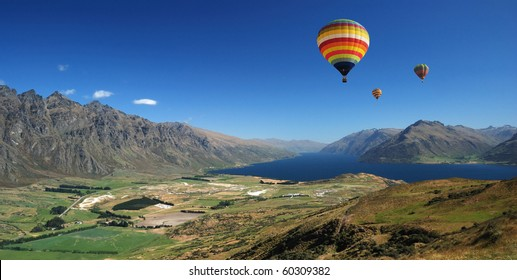 Balloons flying over the mountain