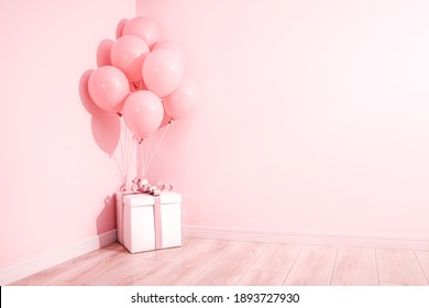Balloons and gift box at the corner of the room