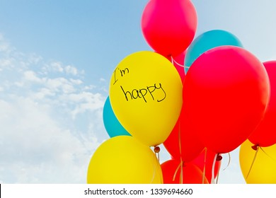 Balloons with the inscription 'I'm happy' against the blue sky .with copy space.