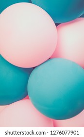 Balloons light turquoise and pink. Background. Close up.