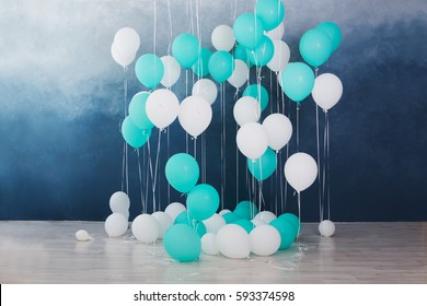 balloons on dark blue wall background. Colorful balloons in room prepared for birthday party.