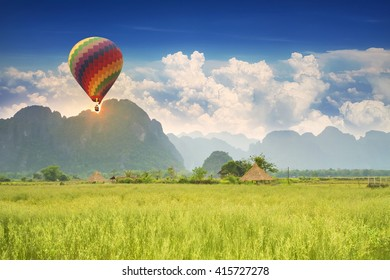 Balloons on the meadows and fields with mountains sunset,Vang Vieng, Laos