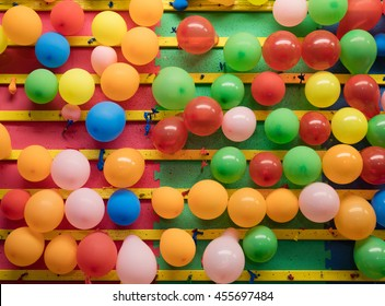Balloons on a wall of an amusement park game