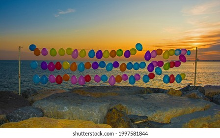 Balloons on the waterfront in the Moda district of Kadikoy on Istanbul's Asian shore - Shutterstock ID 1997581844