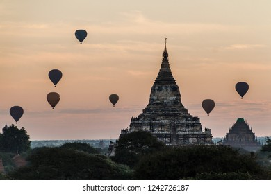 Balloons over Bagan and the skyline of its temples, Myanmar. Sulamani temple and Shwesandaw pagoda.