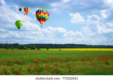 Balloons over the fields of poppy and rape.