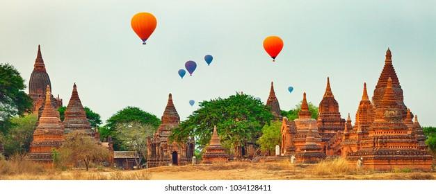 Balloons over Temples at sunrise in Bagan. Myanmar. Panorama