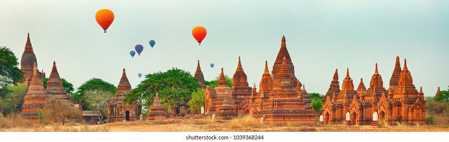 Balloons over Temples at sunrise in Bagan. Myanmar. Panorama