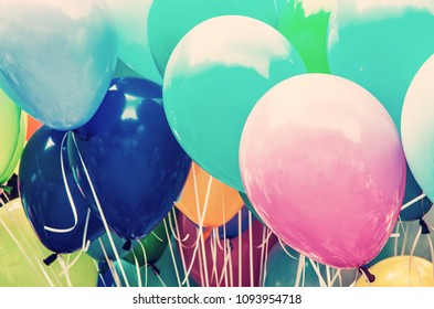 Balloons party. Funny symbolic objects. Leisure activity. Colorful balloons background. Vibrant colors. Retro photo filter.